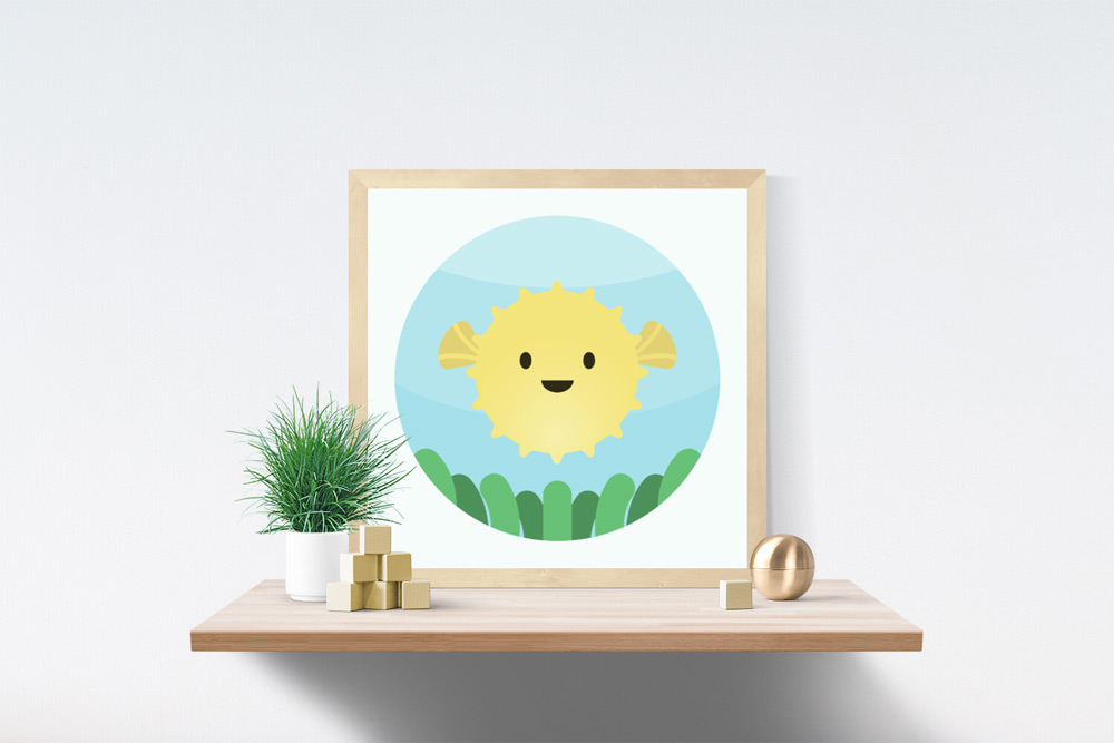 Blowfish Kids Art Illustration in wooden frame a top a wooden shelf. A grassy potted plant, wooden blocks and brass sphere are also on the shelf.
